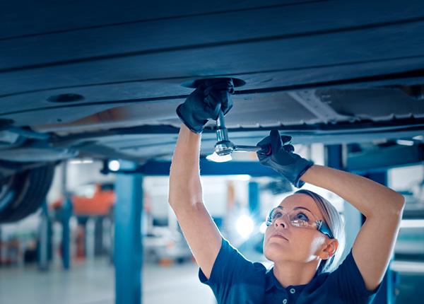 Female Car Mechanic working on a car